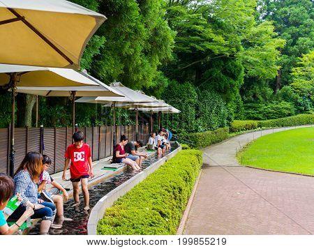 HAKONE, JAPAN - JULY 02, 2017: Unidentified people refresing their foots inside of water at Hakone Open-Air Museum or Hakone Chokoku No Mori Bijutsukan is popular museum featuring an outdoor sculpture park some indoor exhibits Hakone, Japan.
