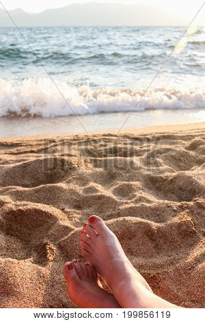 Close up of Woman's Feet Relaxing at the Beach