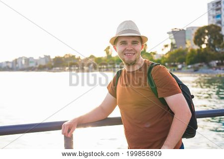 Portrait of an attractive young man on a tropical beach.