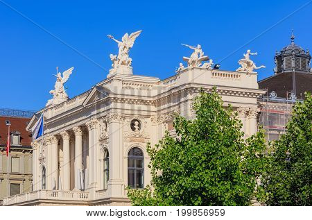 Zurich, Switzerland - 20 July, 2016: upper part of the Zurich Opera House building. Zurich Opera House (German: Opernhaus Zurich) has been the home of the Zurich Opera since 1891, it also houses the Bernhard-Theater Zurich and the Zurich Ballet.
