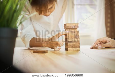 women making a pyramid with empty wooden cubes. Business concept with step-by-step for a firm basis. Vintage style.