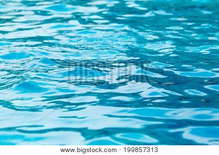The smooth water in the pool as a background .