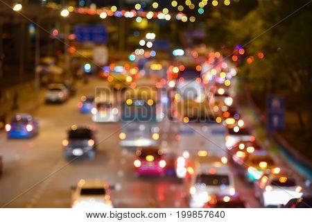 bright circles bokeh from car light streetlamps on defocused photo of night street traffic