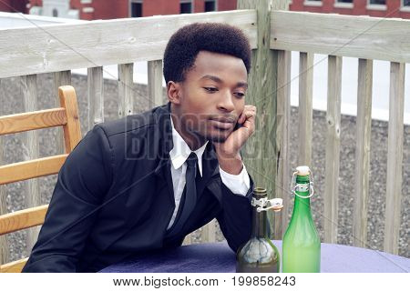 young man drinking bored restaurant dating alone wine bottle