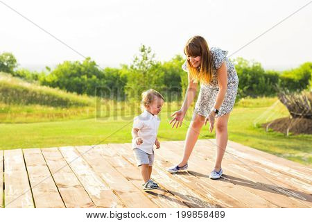 Mother and son on vacation in nature park on twilight time, Mom and kid having fun