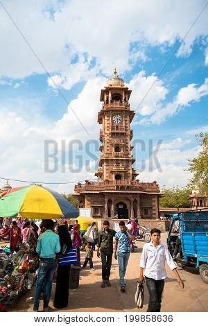 JODHPUR RAJASTHAN INDIA - MARCH 04 2016: People at the Sadar Market. In the back Victorian Clock Tower in Jodhpur the blue city of Rajasthan in India.