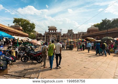 JODHPUR RAJASTHAN INDIA - MARCH 04 2016: Horizontal picture of local people at the Sadar Market in Jodhpur the blue city of Rajasthan in India.