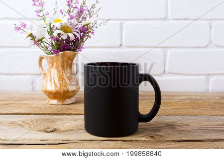 Black Coffee Mug Mockup With Chamomile And Purple Flowers In Golden Pitcher
