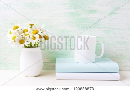 White Coffee Mug Mockup With White Field Chamomile Bouquet In Handmade Rustic Vase And Books