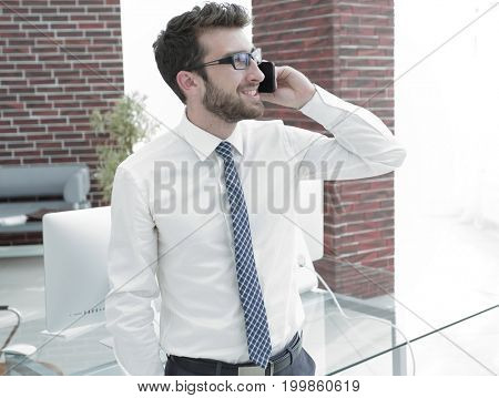Manager talking to a customer on the phone