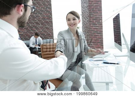 business woman shaking hands with his business partner