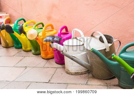 concept of gardening and hobby - A row of watering can.