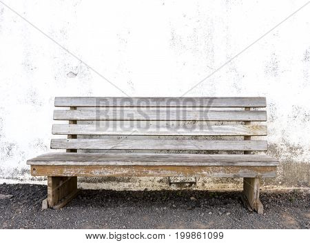 Wooden Bench Against Whitewashed Wall