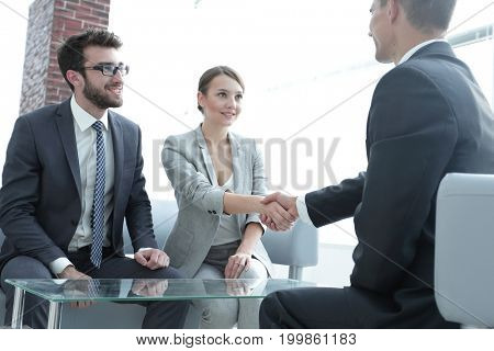 confident handshake business partners