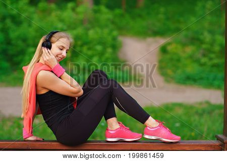 beautiful fitness woman posing, studio shot music