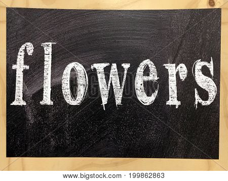 The Word Flowers Written On A Blackboard With Wooden Frame