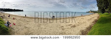 Panoramic view of Browns Bay beach in the East Coast Bays of Auckland New Zealand.