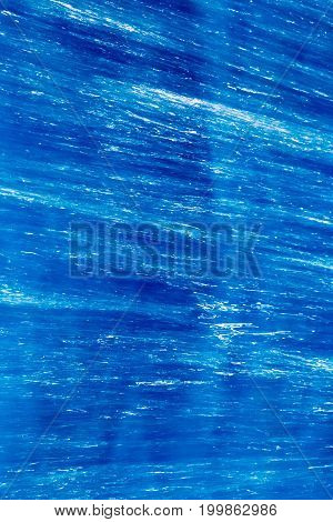 Abstract background of running blue water. texture