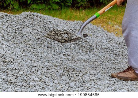 Shovel Throw Stones Into Gabione