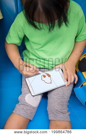 Asian Chinese Little Girl Playing Smart Phone