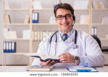 Young man doctor in medical concept
