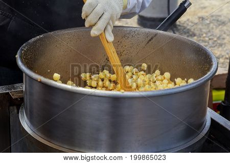Making Popcorn In The Small Kiosk. Heat, Butter And Salt