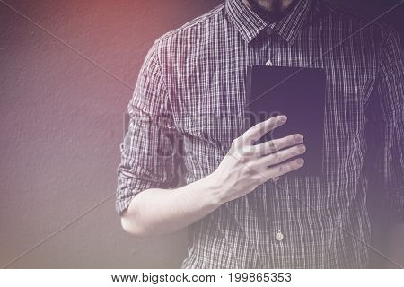Closeup on a man holding a bible at shopping mall believe concept
