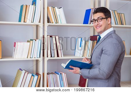 Businessman student reading a book studying in library