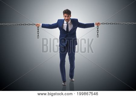 Businessman holding chains in business concept