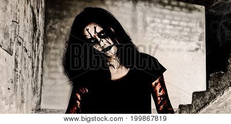 Halloween theme:Ghost Girl Horror on the ruins of an old walkway building with clipping path.
