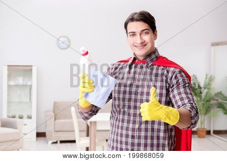 The super hero cleaner doing housework