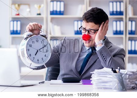 Clown businessman with alarm clock missing dieadline