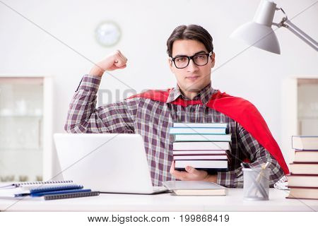 Super hero student with a laptop studying preparing for exams