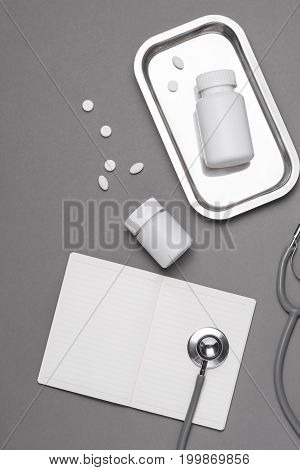 Top View Of Doctor Desk Table With Stethoscope And Medical Items. Flat Lay.