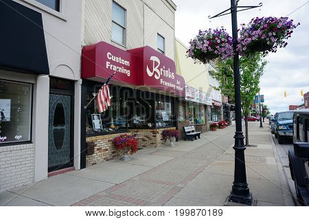 CADILLAC, MICHIGAN / UNITED STATES - MAY 31, 2017:  One may have pictures framed at Brinks Custom Framing and Art Supplies, on Mitchell Street in Downtown Cadillac.