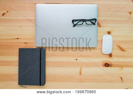 Personal computer and equipment on table wooden top view Business concept.