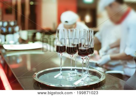 Sweet Wine In Wine Glass On Bar For Service In Luxury Dinner Party, Blurry Background With Vintage C