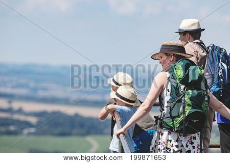 Lilienstein Germany - August 14 2017. Happy family is on a trip looking out of the landscape. Concept of a happy sports family. Family with hats on the head.