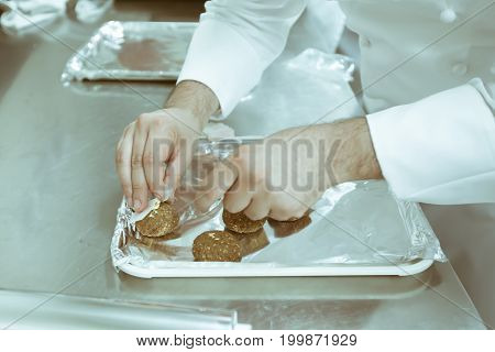 Chef Using Chopsticks Tong Sliced Beef Put On The White Plate In Luxury Dinner Party, Blurry Backgro