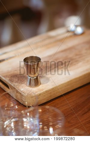 Measuring Cup For Making Cocktails On Chopping Wood On The Wood Table In Luxury Dinner Party, Blurry