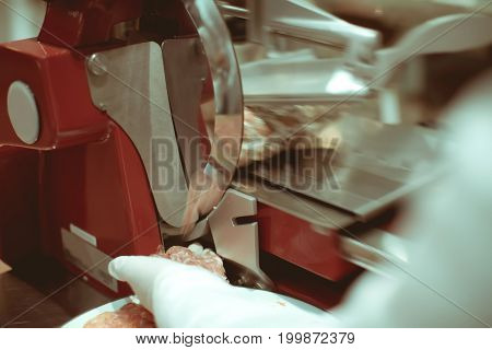 Meat Slicer Machine Cutting Beef In Luxury Dinner Party, Blurry Background With Vintage Color Style.