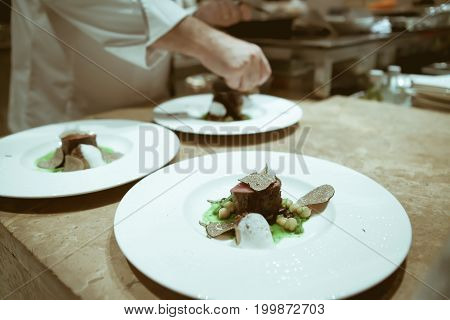 Blurry Background Vintage Color Style Of Chef In Hotel Or Restaurant Kitchen Cooking And Decorating