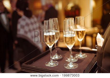 Blurry Background Waiter Serving Champagne To Customer In Restaurant.