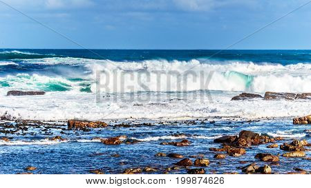 Waves of the Atlantic Ocean breaking on the rocky shores of Cape of Good Hope in Cape Point Nature Reserve on the Cape Peninsula in South Africa