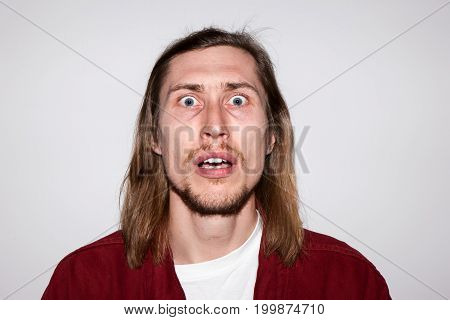 Surprised young male. Shocking news. Astonished man emotion, handsome guy portrait, facial expression concept