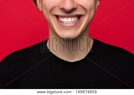 Stomatology advertising. White male teeth closeup. Unrecognizable usual man with wide smile, oral health care, dental concept