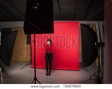 Woman tired of the model business. Photoshoot backstage, fashion lifestyle, exhausted girl