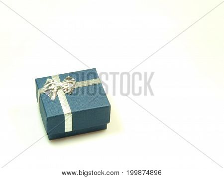 Little present wrapped in blue and silver