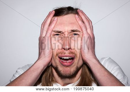 Crying adult male. Man headache. Troubles in life, very upset guy, emotional concept