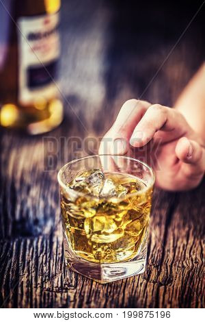 Alcoholism.hand Alcoholic And Drink The Distillate Whiskey Brandy Or Cognac.